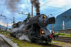 Old steam train engine letting off the steam Royalty Free Stock Photo