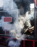 Old Steam Train. Getting ready for a trip. Conductor booth and mechanism detail Stock Photo