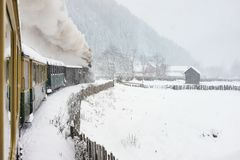 Old steam train. In the middle of the winter running through snow abundance royalty free stock images