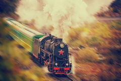 Old steam train in motion stock image