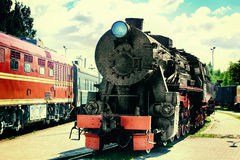 The old steam train at a railway station Stock Photo