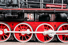 Old steam train, red wheels closeup. Vintage locomotive. Railway engine, ancient railroad vehicle Royalty Free Stock Photos