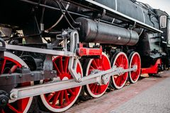 Old steam train, red wheels closeup Royalty Free Stock Photos