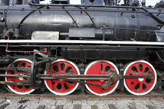 Old steam train's wheels. Close-up of an old steam train's wheels Stock Image