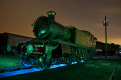 Old steam Train at sidings light painted Stock Image