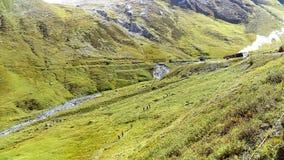 Steam train in the swiss alps Stock Photo