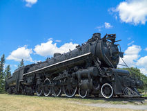 Old steam train on tracks Royalty Free Stock Image