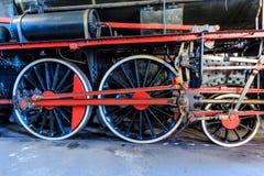 Old steam train wheels closeup. Old steam train engine drive train closeup Stock Image
