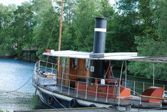Old steamboat for tourists in the canal Royalty Free Stock Image