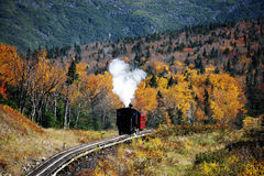 Old steamed cog train in autumn mountain forest Stock Image