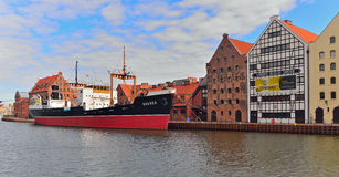Old steamer in harbor. Old cargo steamer mooring near buildings of the National Maritime Museum the harbor of Gdansk, Poland Stock Photography