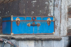 Old Steamer Trunk on Weathered Wood Shelf Stock Photo