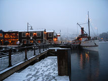 Old steamer at wharf in winter Royalty Free Stock Photos