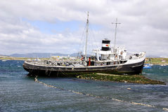 Old steamship. At the bay of Beagle Channel on november 29 2011 in Ushuaia, Argentina. It is commonly regarded as the southernmost city in the world Royalty Free Stock Image