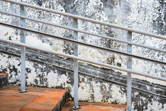 Old Steel banisters and old cement wall. Cracks with paint peeling Royalty Free Stock Photos