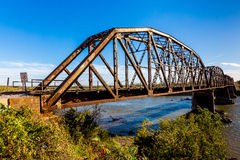 Old Steel Beam Railroad Bridge. An Iconic Old Metal Truss Railroad Bridge in Texas Royalty Free Stock Photo