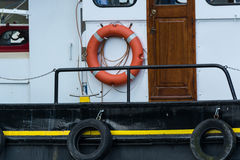 Old steel boat with lifebuoy Stock Images