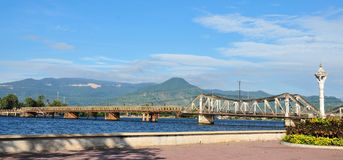 Old steel bridge with mountain background in Kep town, Cambodia Royalty Free Stock Images