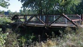 Old steel bridge over a creek Royalty Free Stock Photos
