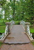 Old steel bridge in the palace park in Gatchina Royalty Free Stock Images