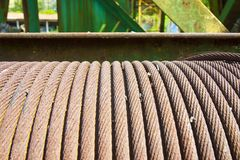 Old steel cable wrapped up in a coil Stock Images