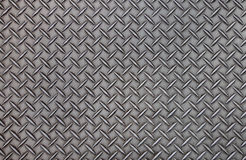 Old steel diamond plate pattern background texture. Royalty Free Stock Images