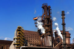 Old steel factory. With smoke stock images