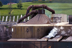 Old steel factory with steam. In natural environment stock photo
