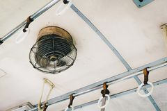 Old steel fan rotate in Thailand old vintage SRT train on vintage style, circular ceiling fan, hand-grip rows installed in third stock images