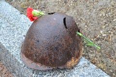 Old steel helmet on war memorial Stock Photography