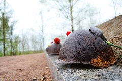 Old steel helmet on war memorial Stock Photos