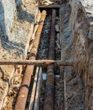 Old steel pipe in pit on day stock images
