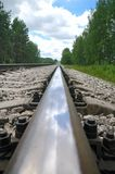 Old steel railroad tracks. Close-up macro with reflection Stock Image