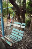 Old steel swing on the field of urban park. In the garden Stock Photo
