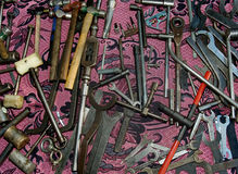 Old steel and wood tools. A collage of old steel tools up for sale on a craft market Royalty Free Stock Photos