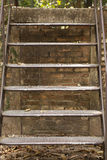 Old step ladder. Old steel ladder outside a house Royalty Free Stock Photo