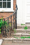 Old steps. Entrance to a town house in need of repair royalty free stock photography