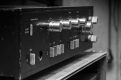 Old stereo amplifier in black with silver handles. Selective focus stock photography