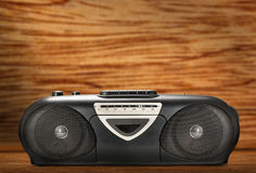 Old stereo tape recorder. On wooden background stock photos