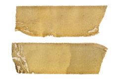 Old Sticky Tape Strips over White. Very old adhesive tape strips, isolated on white background.  Great textures Royalty Free Stock Image