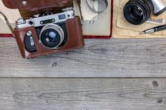 Old still camera in leather case, photo album and old pictures o Stock Images
