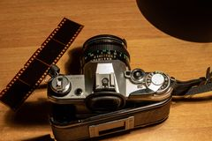An old still working camera, his films to be developed. His telephoto lenses and wide-angles, his flash stock photo