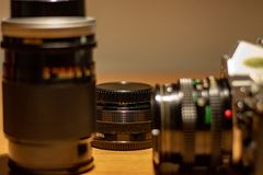 An old still working camera, his films to be developed. His telephoto lenses and wide-angles, his flash stock images