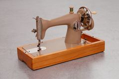 Old stitching machine is on grey background Royalty Free Stock Photography