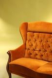 Old stlye sofa on green background Stock Photos