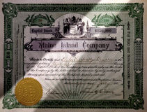 INVESTMENT STOCK FUND WEALTH FINANCIAL PLANNING MANAGEMENT METAPHOR. Spotlight on Old Time Stock Certificate, Wealth Planning and Financial Management investment stock photography