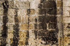 Background of stone wall texture. Old stone ancient castle wall background royalty free stock images