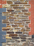 Old Stone And Painted Brick Decorated Wall. Stock Image