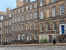 Old stone apartment buildings Stock Photos