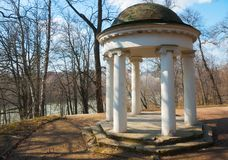 Stone arbor in park, Gorki Lenin Museum-Reserve  in spring, Moscow region, Russia. Old stone arbor in park, Gorki Lenin Museum-Reserve  in spring, Moscow region Stock Photos